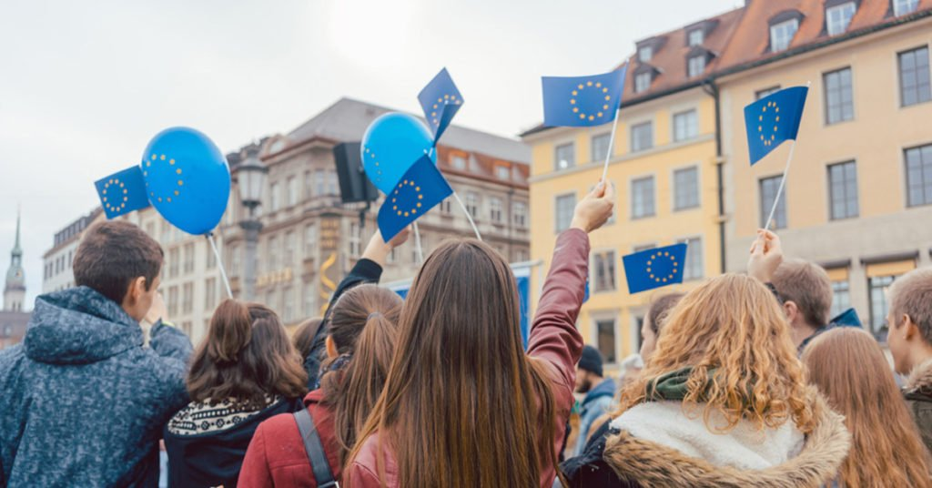 People on rally or demonstration supporting the EU waving flags